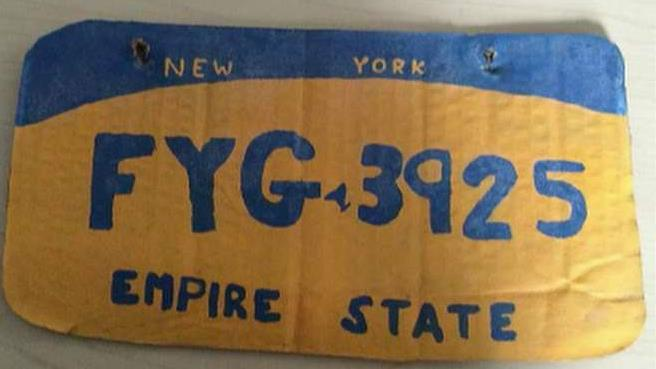 Woman arrested for driving with fake New York license plate