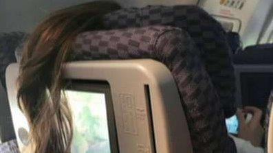 Plane passenger's 'awful' ponytail placement goes viral