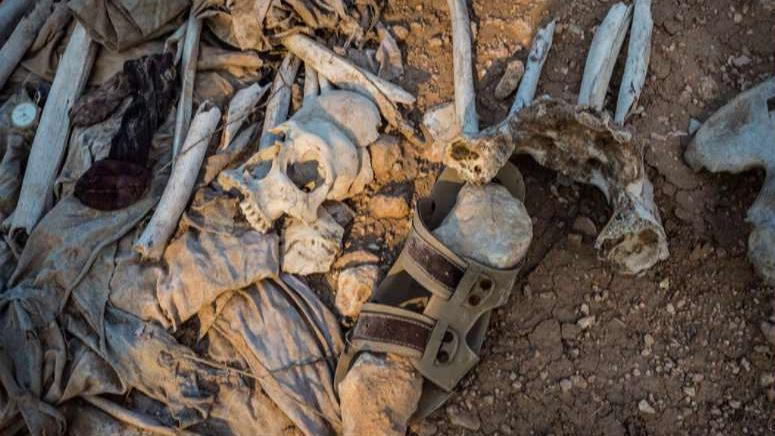 Thousands buried in at least 72 ISIS mass graves, AP finds