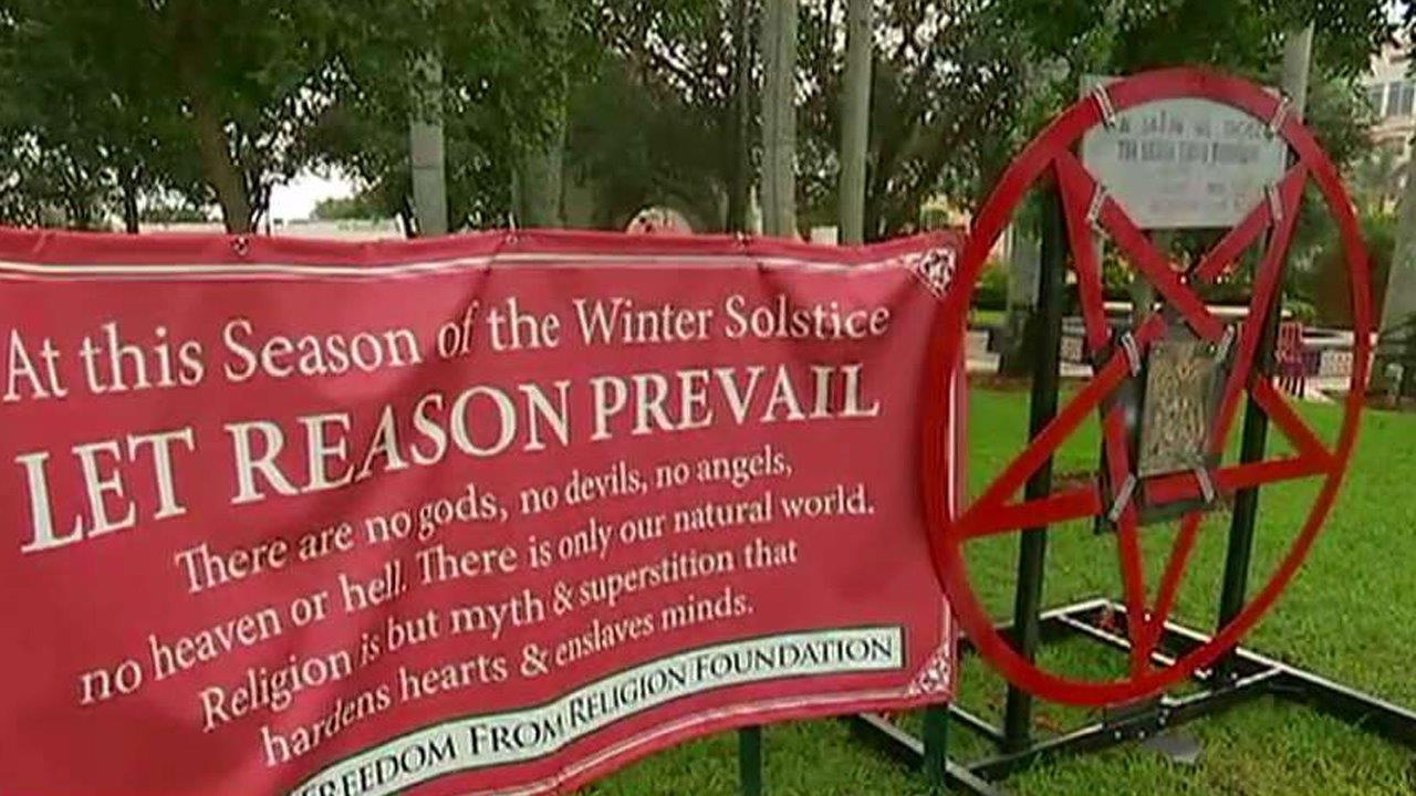 Satanic display erected next to city's Christmas nativity