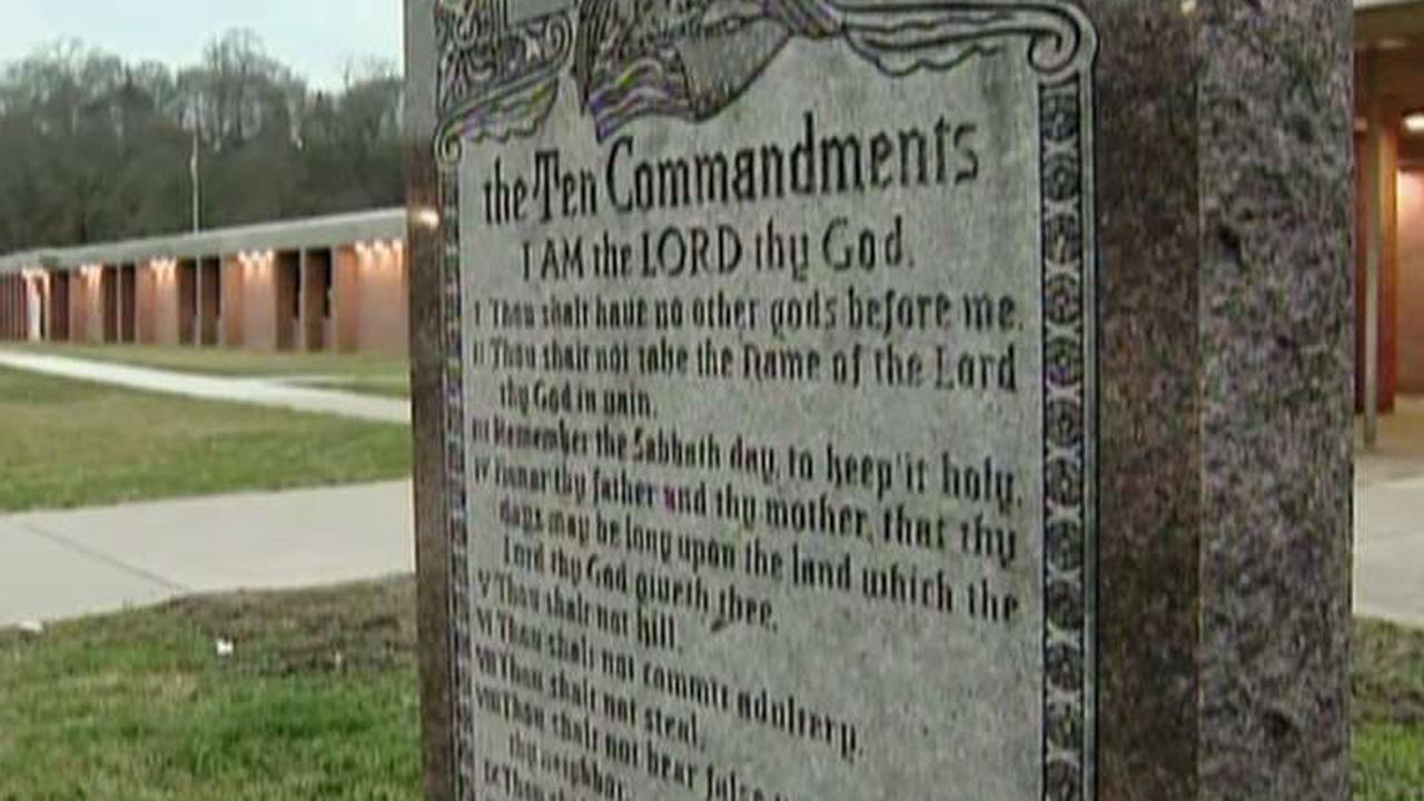 Atheist forces school to drop Ten Commandments
