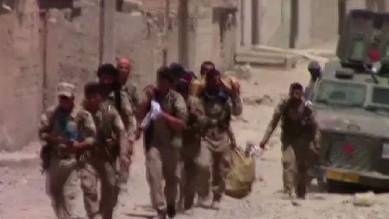 US-backed Syrian forces hit key milestone in Raqqa