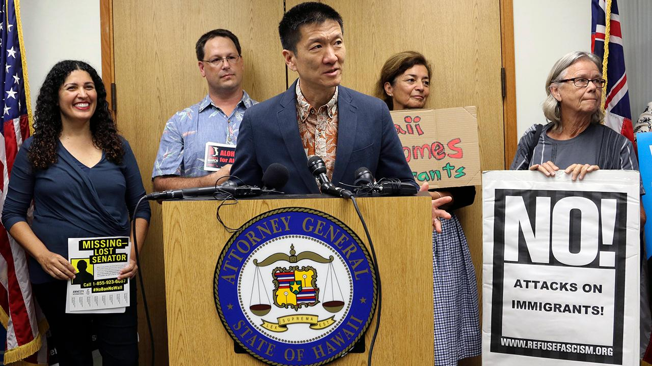 Hawaii judge temporarily blocks latest version of travel ban