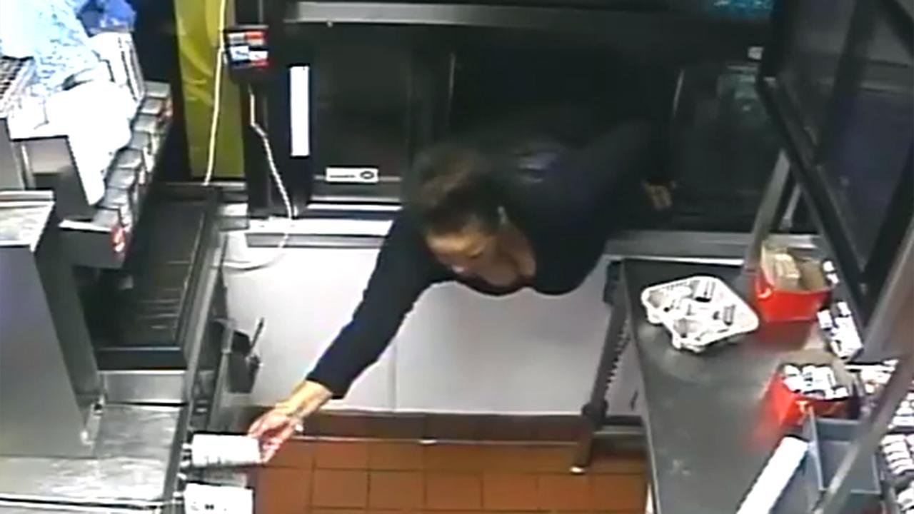 Woman climbs through drive-thru window to steal food, cash