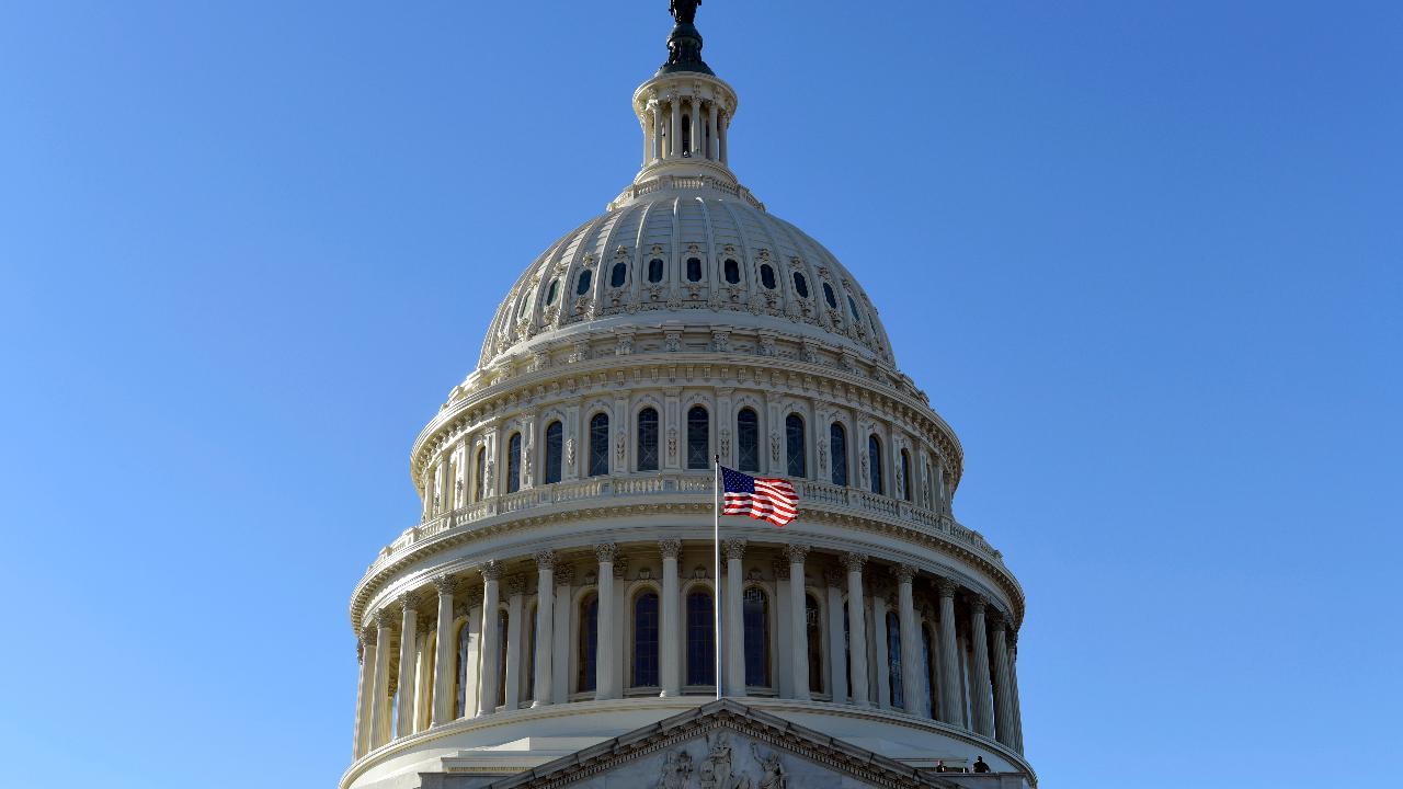 Congress passes bill to avert government shutdown, setting up pre-Christmas showdown