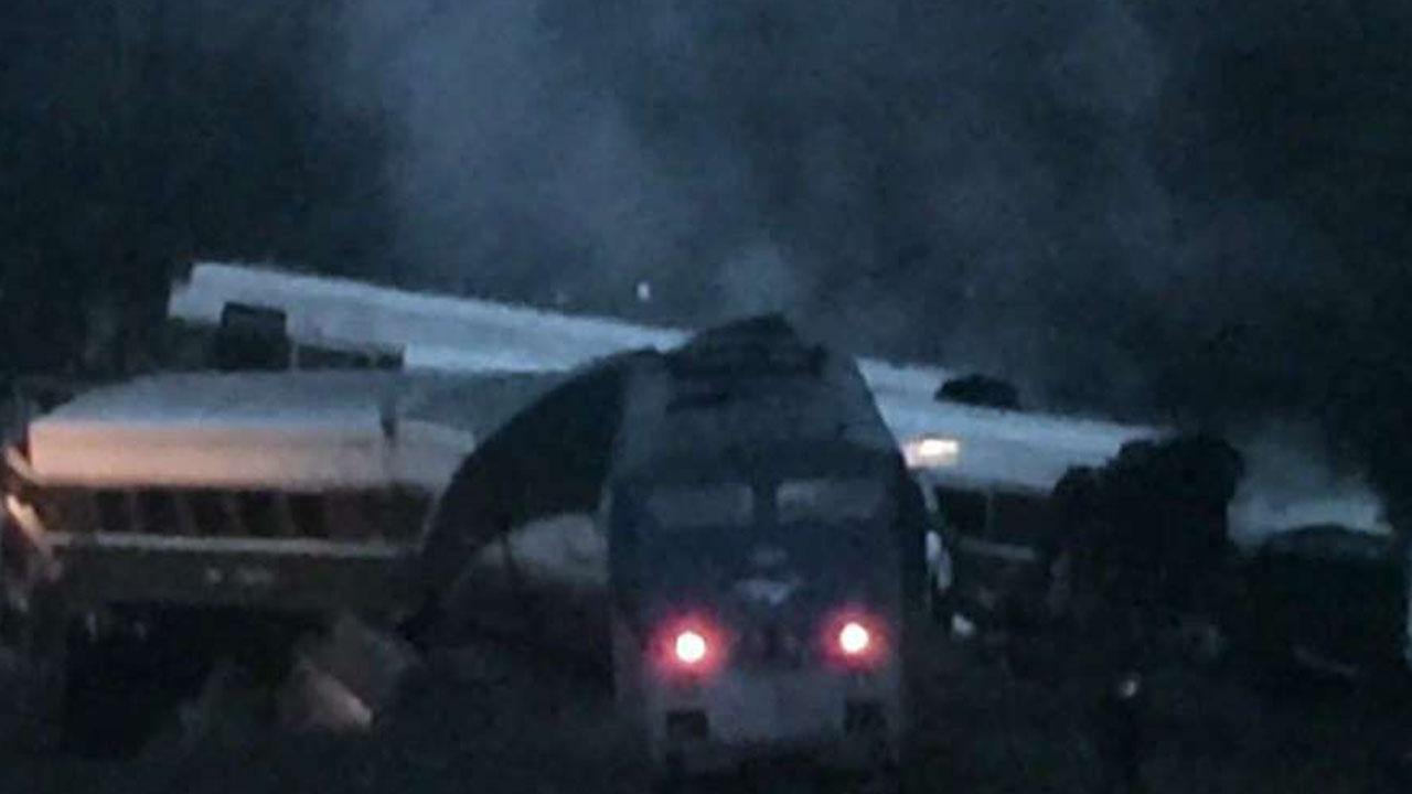 Official: Amtrak engineer in crash may have been distracted
