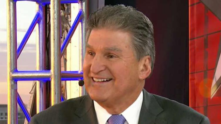Sen. Manchin reacts to Democrats staying seated at SOTU