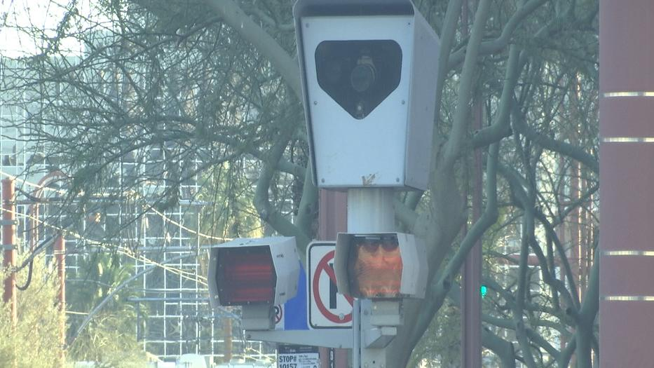 Photo red light, speed enforcement at intersection of debate