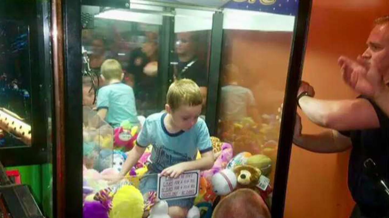 Boy gets stuck inside claw machine at Florida restaurant