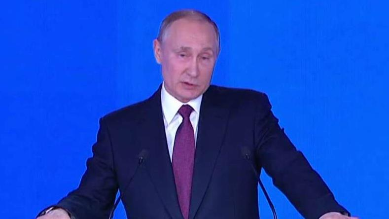 Putin shows off 'invincible' weaponry in address