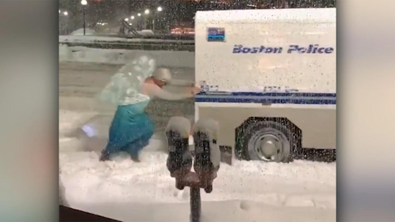 Man dressed as Disney's Elsa frees police van from snowbank
