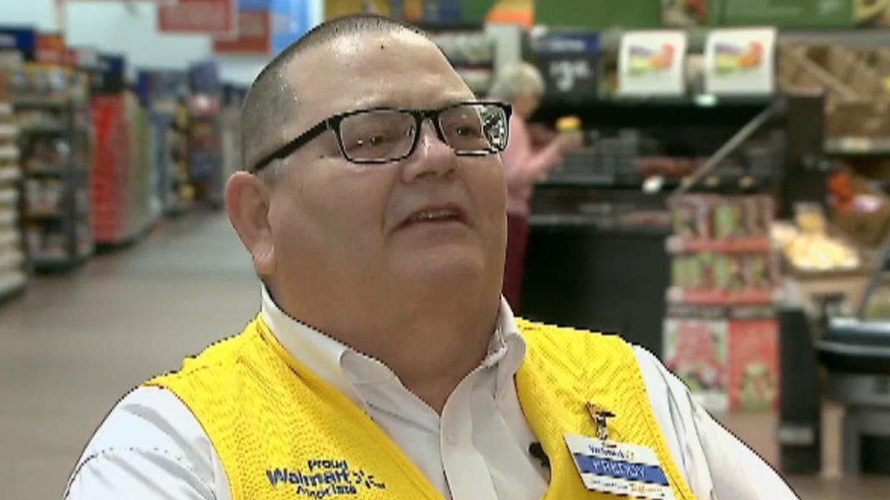 Ohio Walmart greeter honors local veterans by singing anthem
