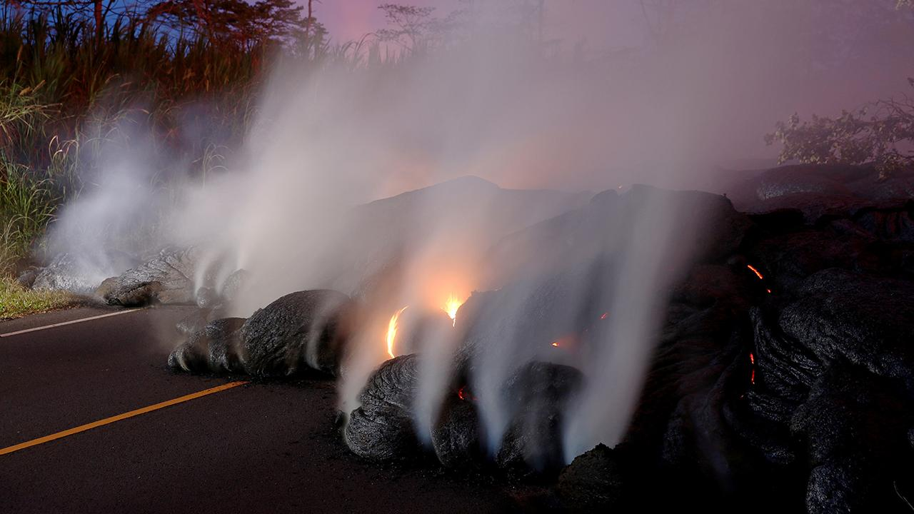 New lava flow covers crucial highway in Hawaii