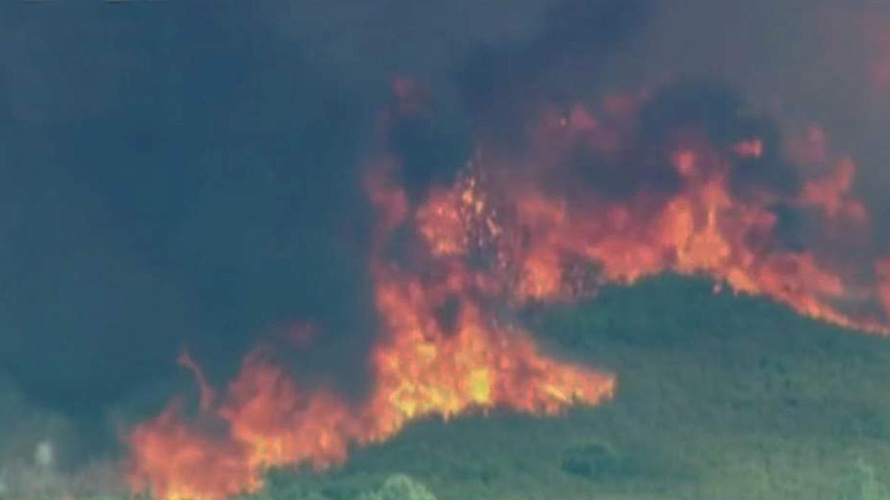 Deadly Carr wildfire swells to nearly 100,000 acres