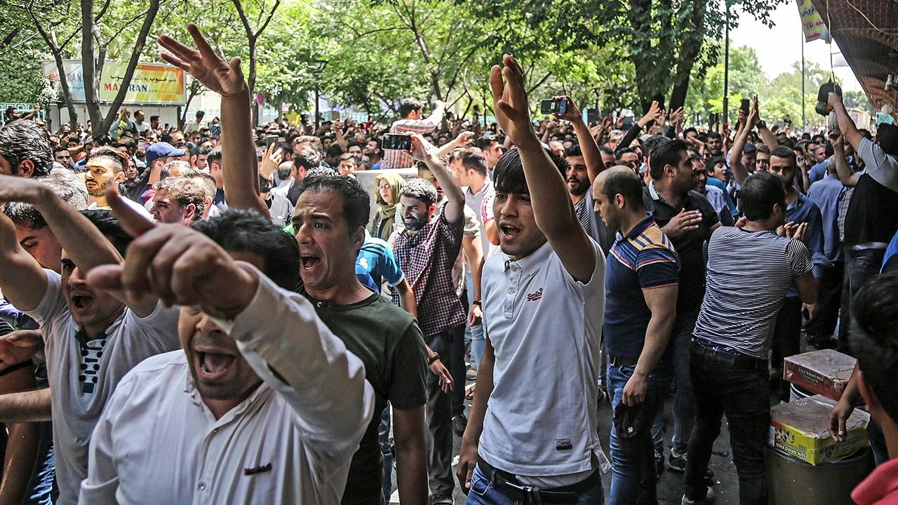 Iran crowds reportedly chant 'death to the dictator!' as US sanctions increase economic unrest