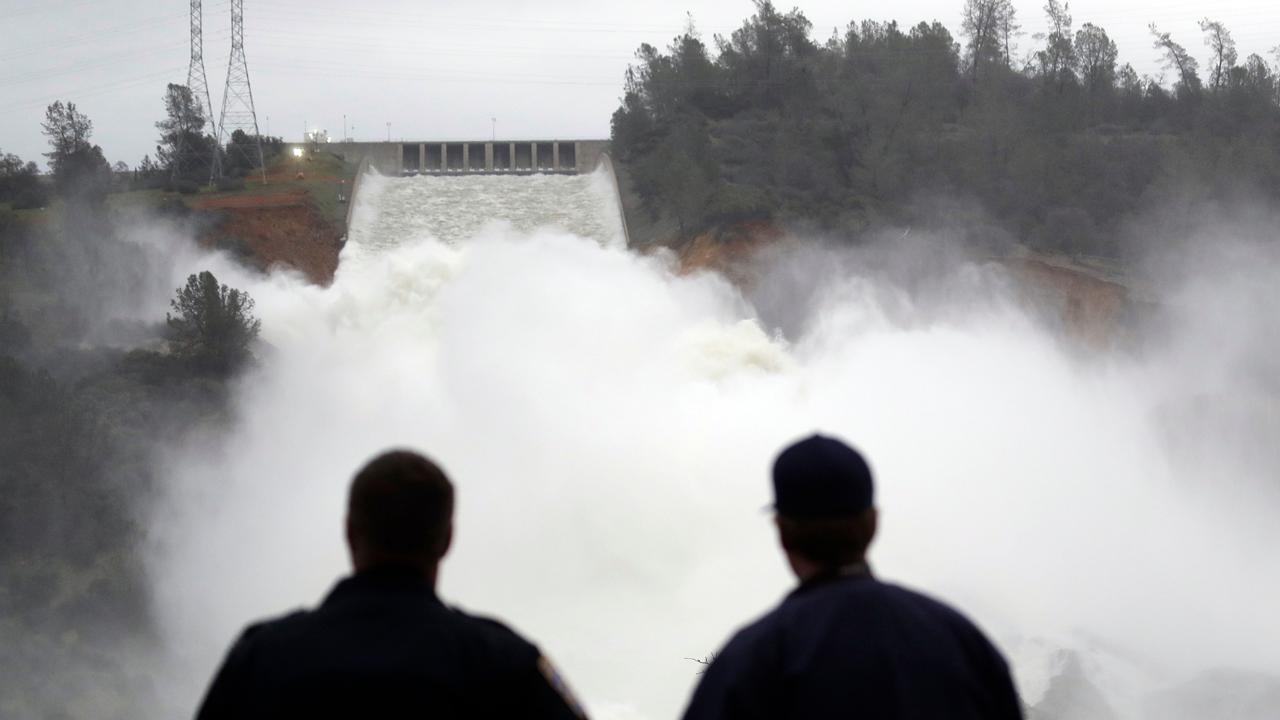 Water flows down California dam's rebuilt spillway after
