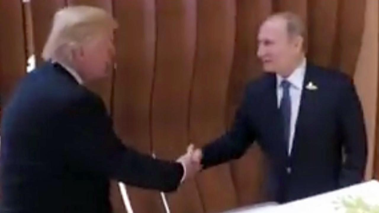 Trump, Putin shake hands ahead of highly anticipated meeting