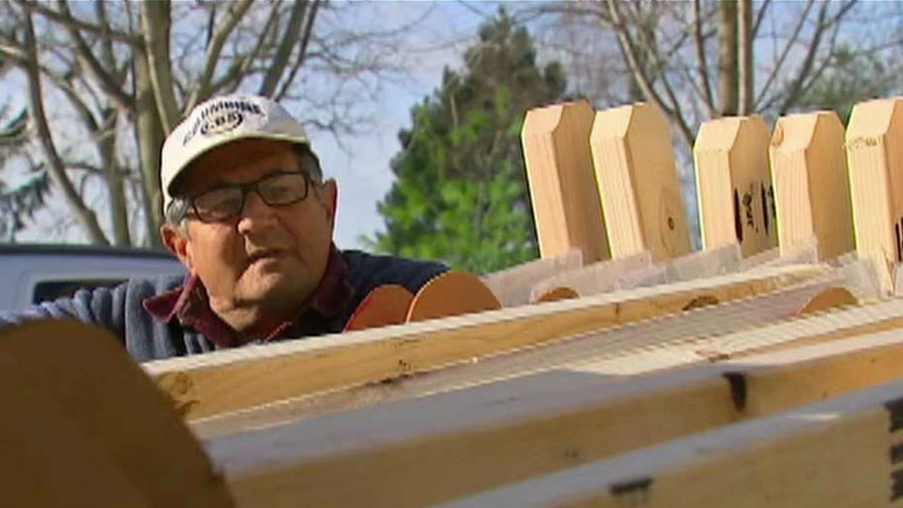 Man builds crosses to remember mass-shooting victims