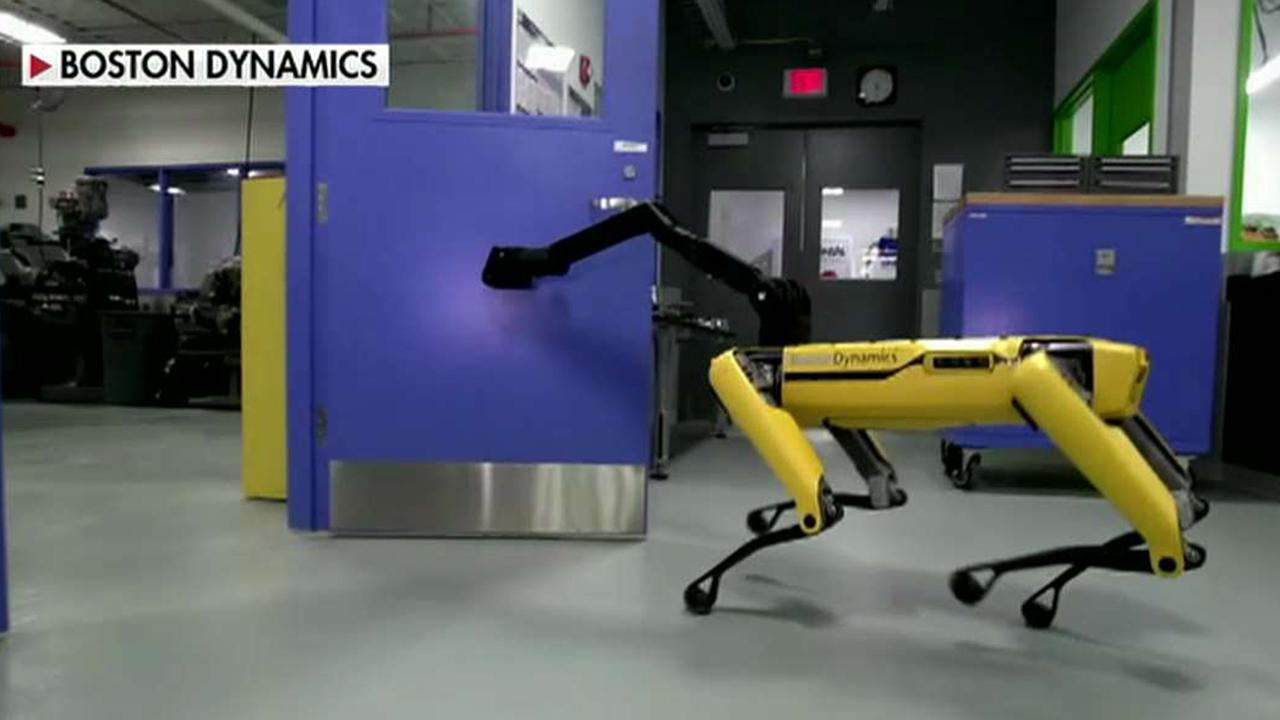 Robots are working together to open doors