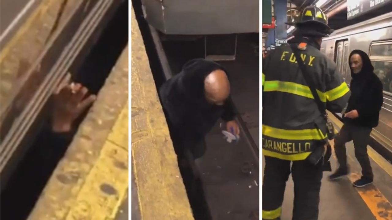 Man emerges from underneath NYC subway shocking commuters