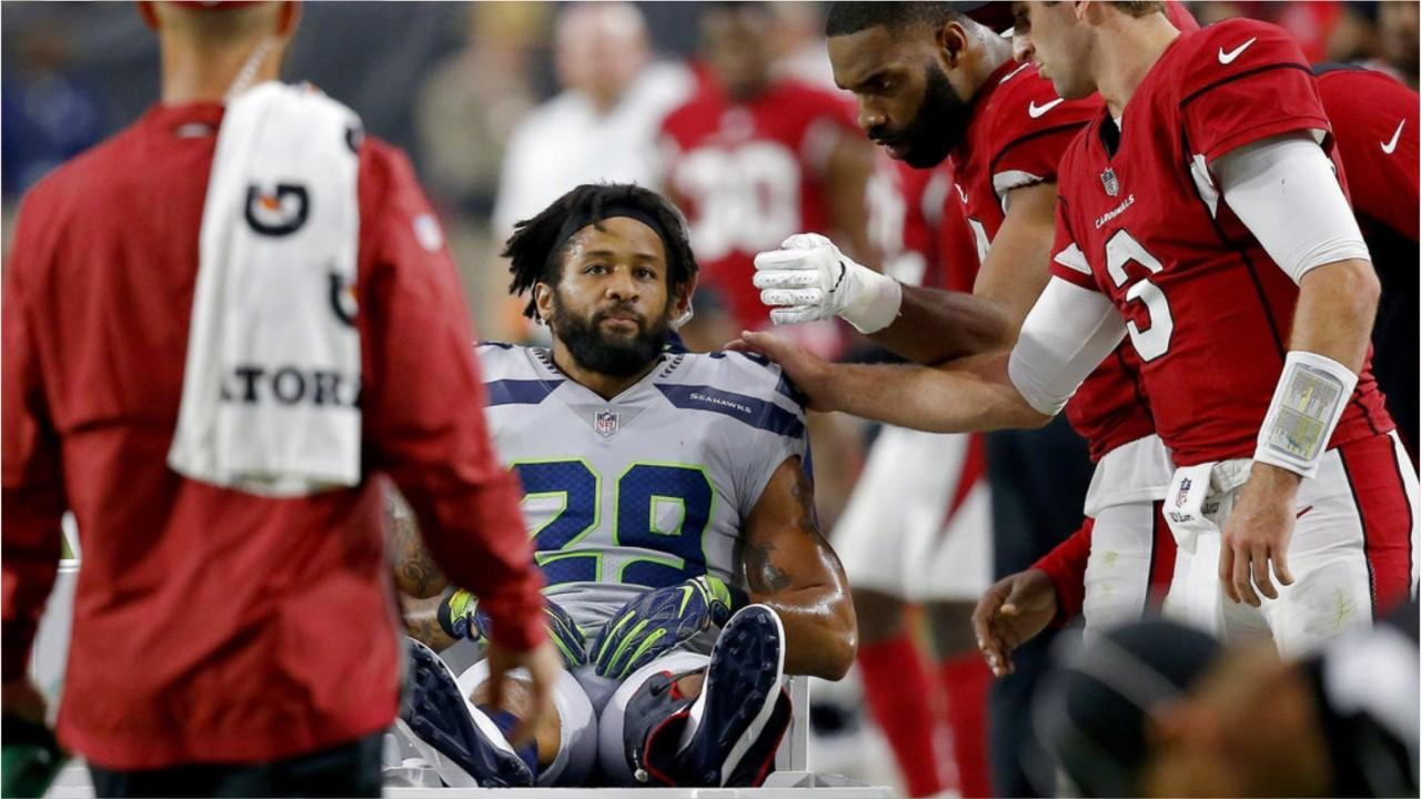 Seattle Seahawks safety Earl Thomas suffered a severe injury Sunday, and as he was leaving the field and gave his team the 'finger,' allegedly after he wasn't granted an extension.