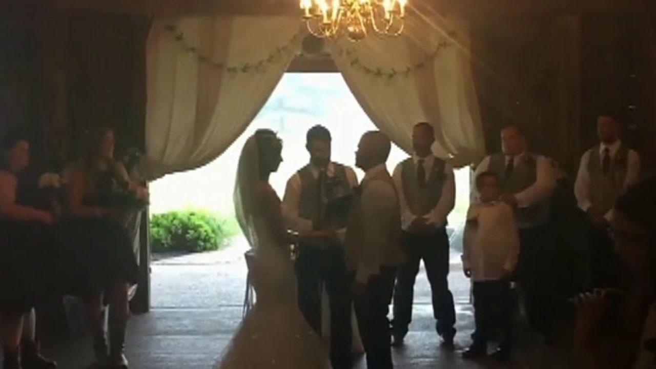 Wedding photographer shoves a bride's step mother