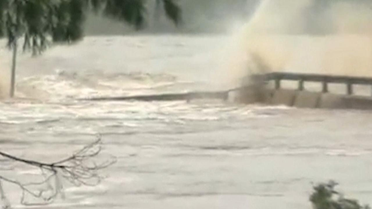 Raging Texas floodwaters cause bridge to crumble, spur evacuations