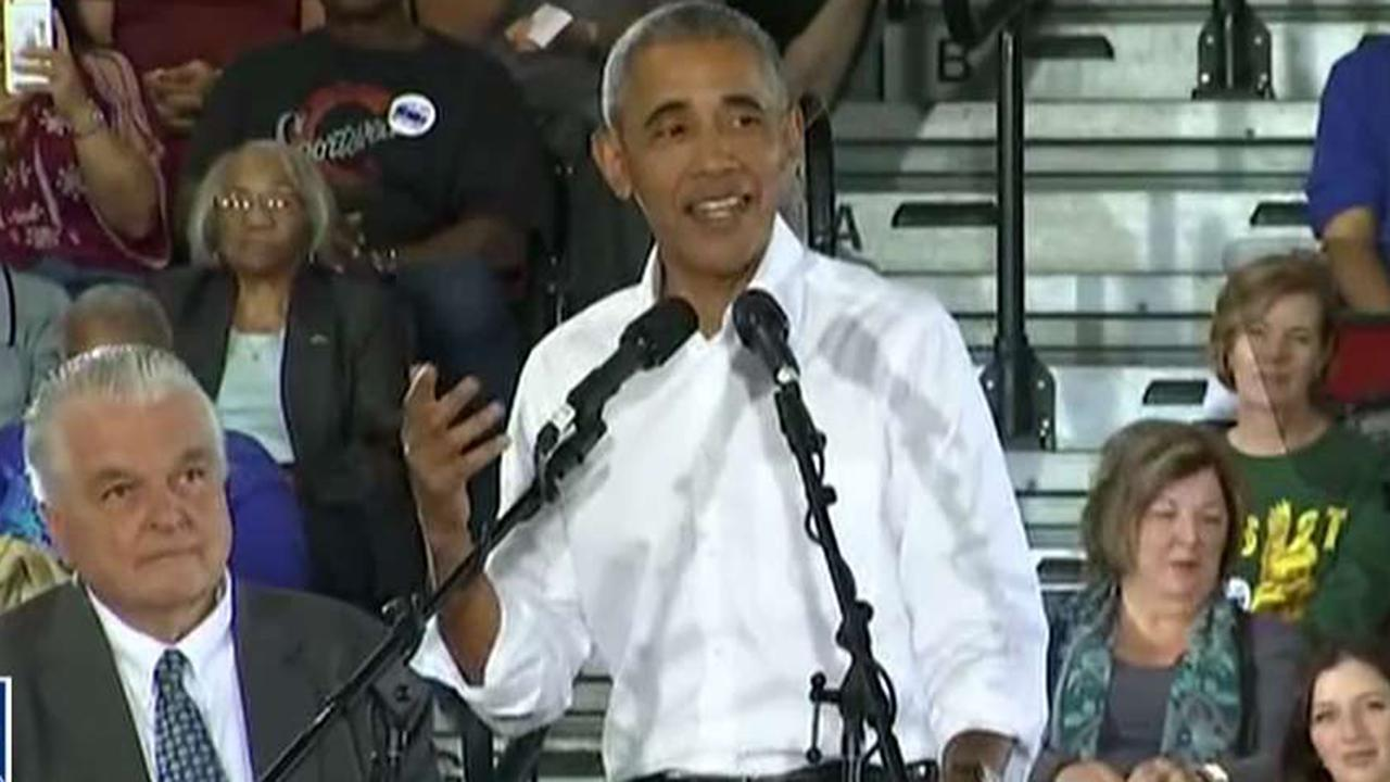 Obama takes credit for economy during rally