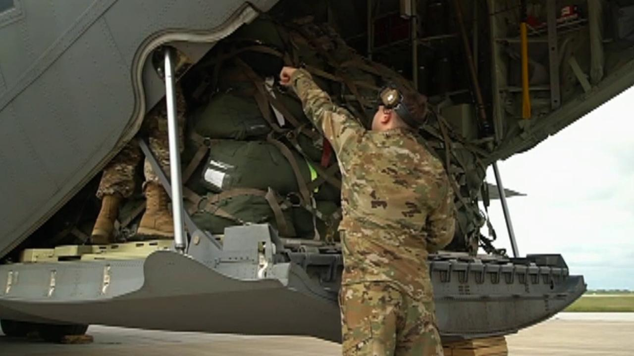 Raw Video: Troops and military equipment arrive in Texas