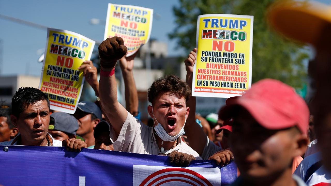Trump proposes new asylum rules as caravan approaches