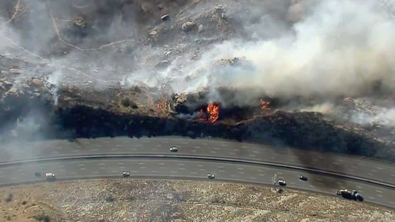 Firefighters battle brush fire in Simi Valley, California