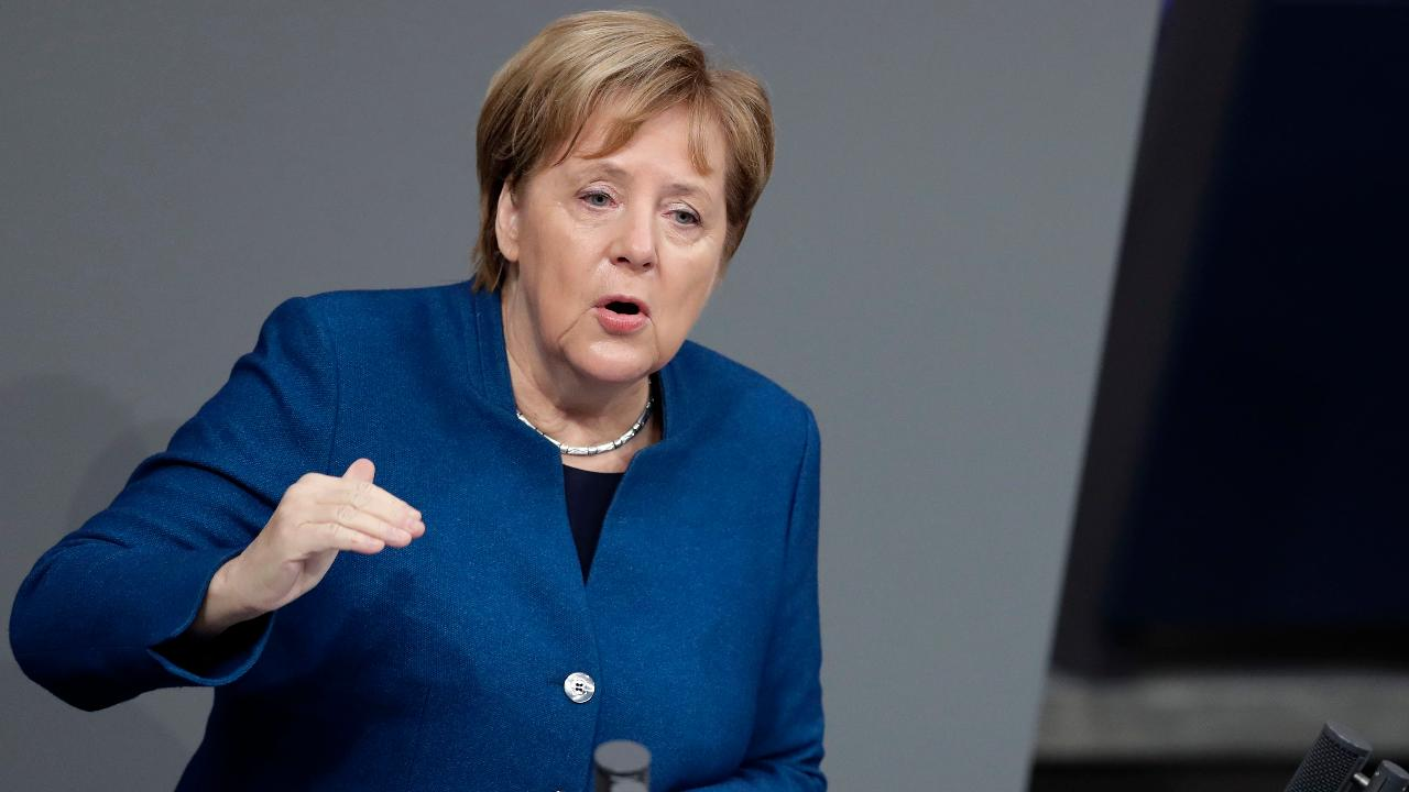 Merkel takes veiled swipe at Trump over nationalism
