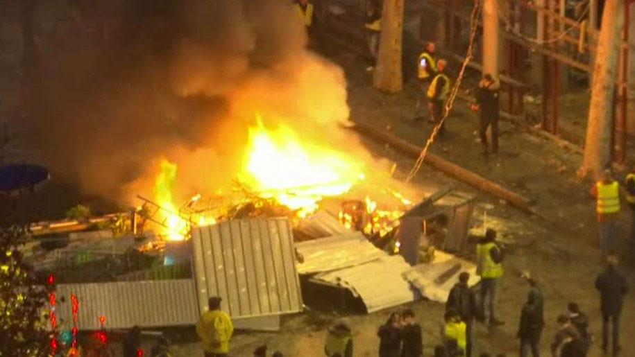 Gas-price protesters burn scaffolding in Paris