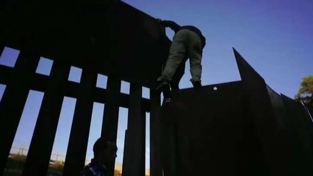 Several migrants breach US-Mexico border