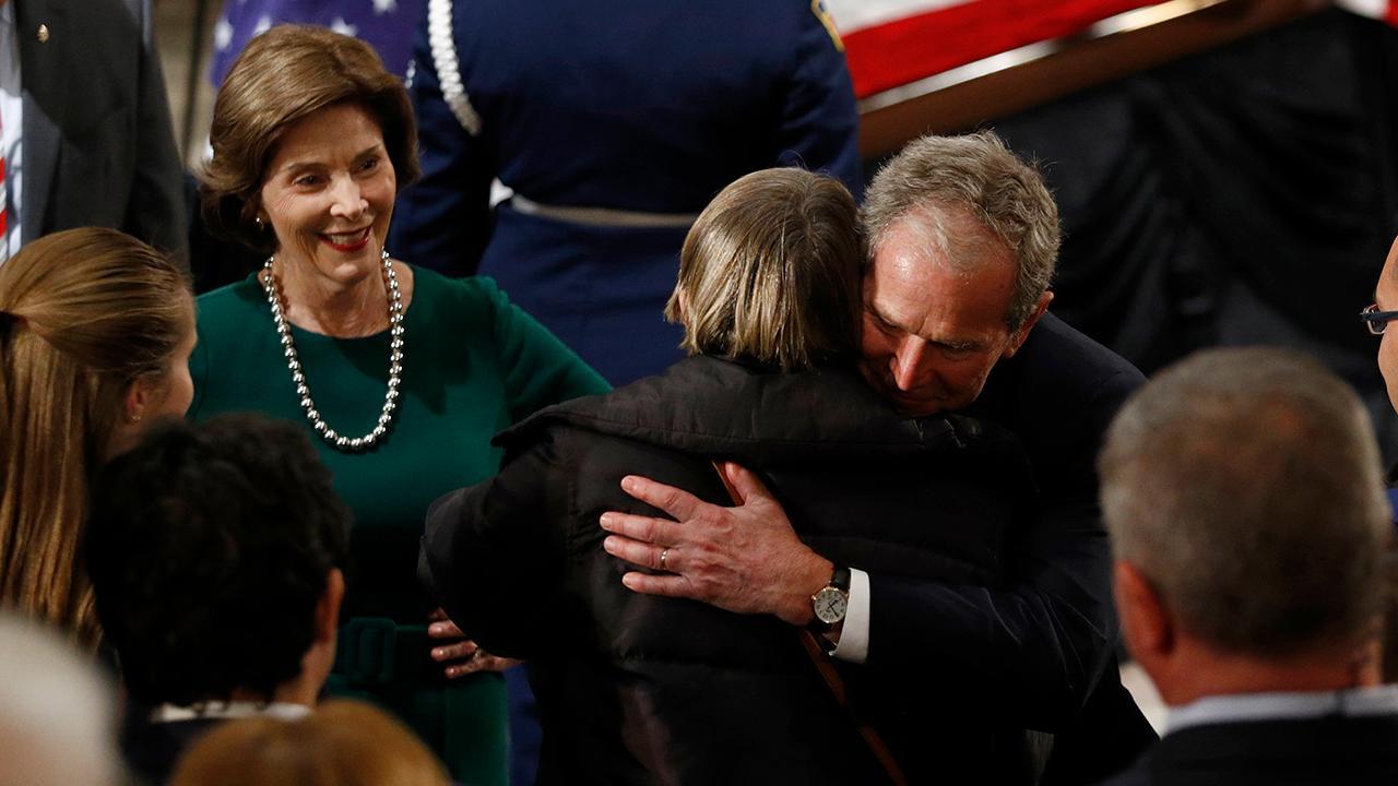Bush family arrives at Capitol rotunda, greet mourners