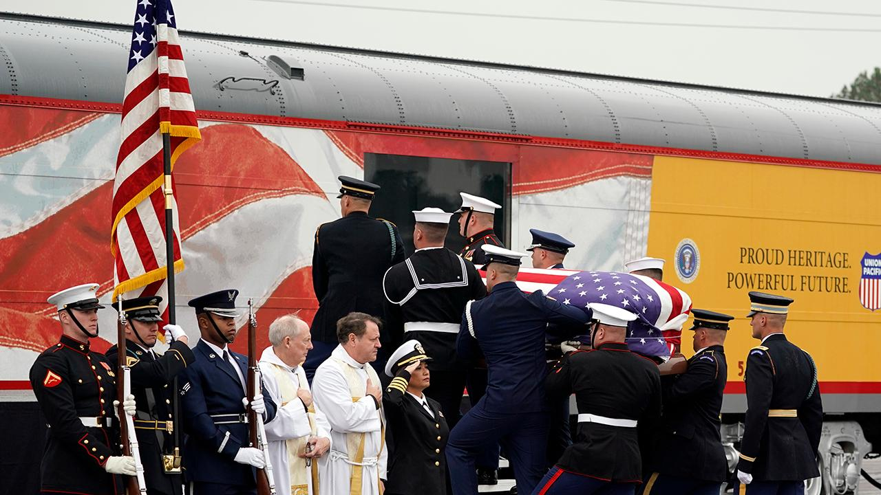 George H.W. Bush casket carried onto funeral train