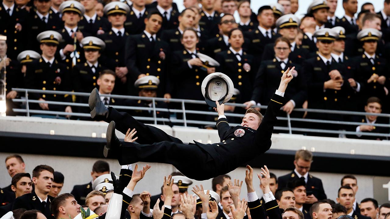What does the Army-Navy game mean to players and military?