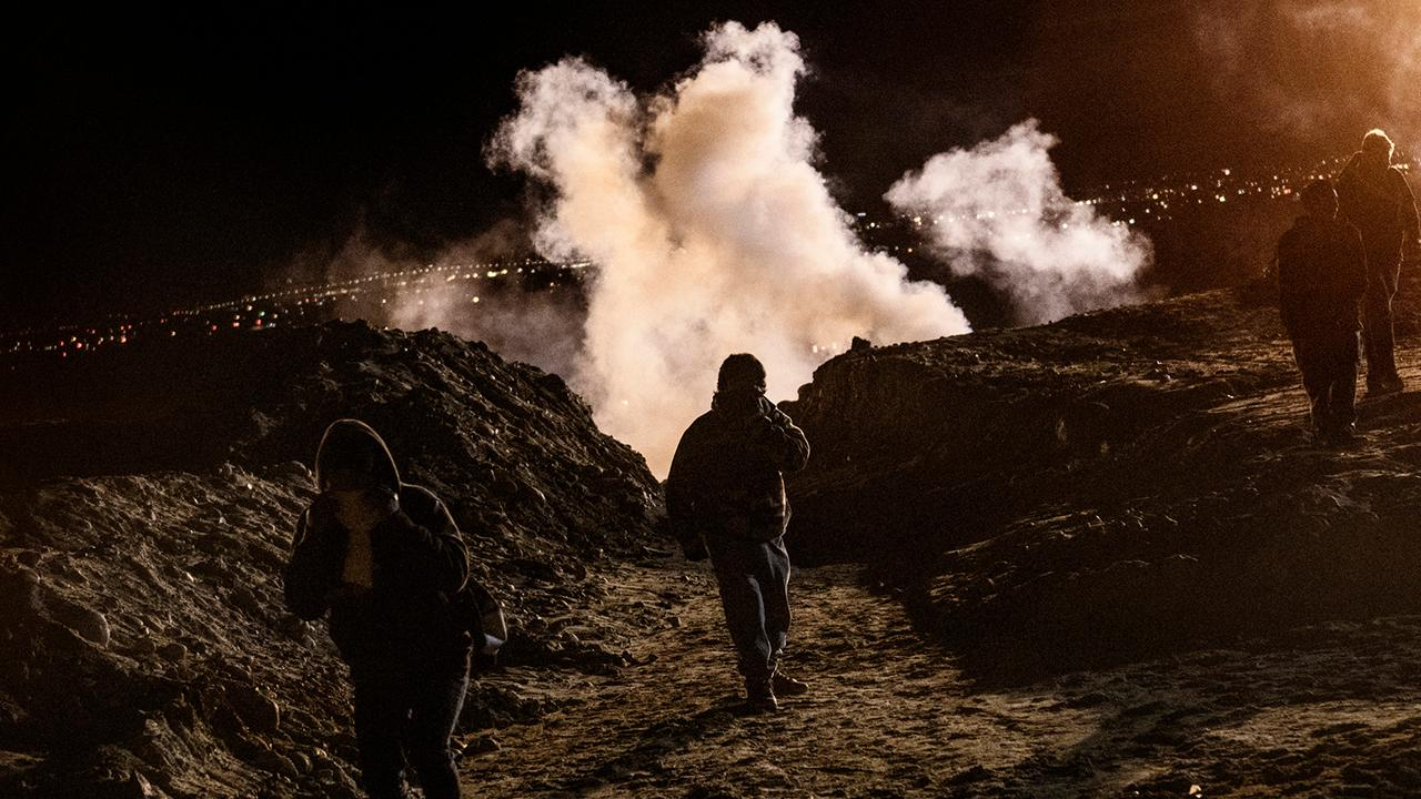 US officers fire tear gas and pepper spray as 150 rock-throwing migrants violently engaged CBP after crossing the border