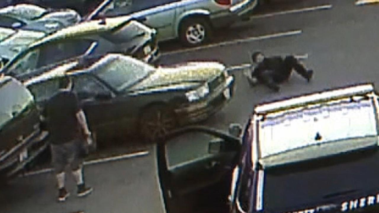 Surveillance video shows teen suspect ram her car into police officer in Washington