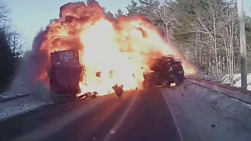 Father and son rescue driver from burning car following crash with a semi-truck