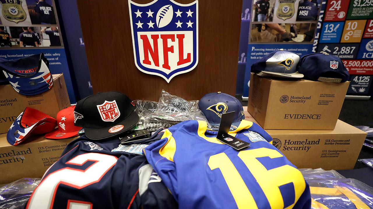 NFL officials warn football fans to watch out for counterfeit Super Bowl tickets, merchandise