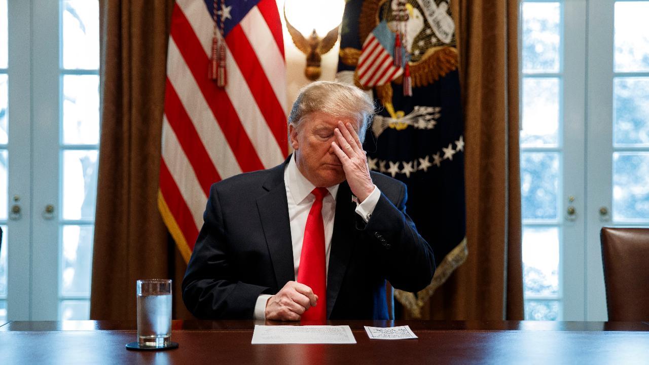 Trump blames media for intel rift