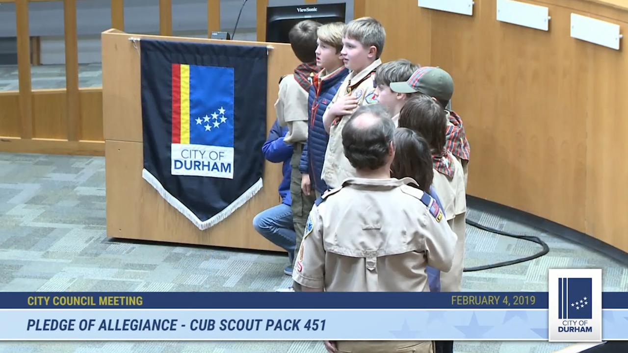 10-year-old Cub Scout takes a knee during Pledge of Allegiance at city council meeting in North Carolina