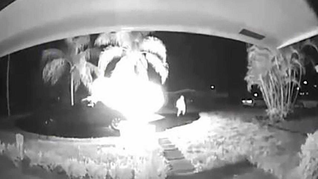 Surveillance camera catches hooded suspect setting fire to Florida woman's car