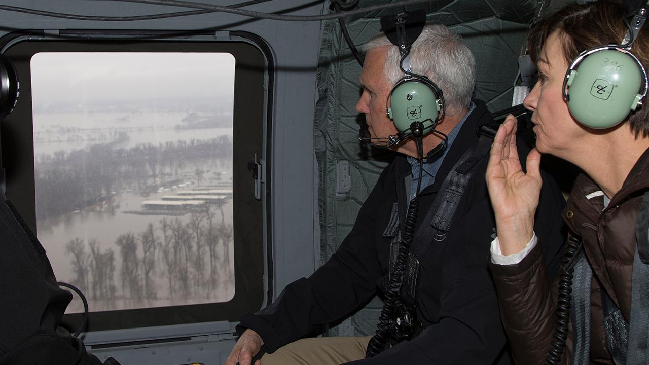Pence promises help is on the way for flood-hit towns in Midwest