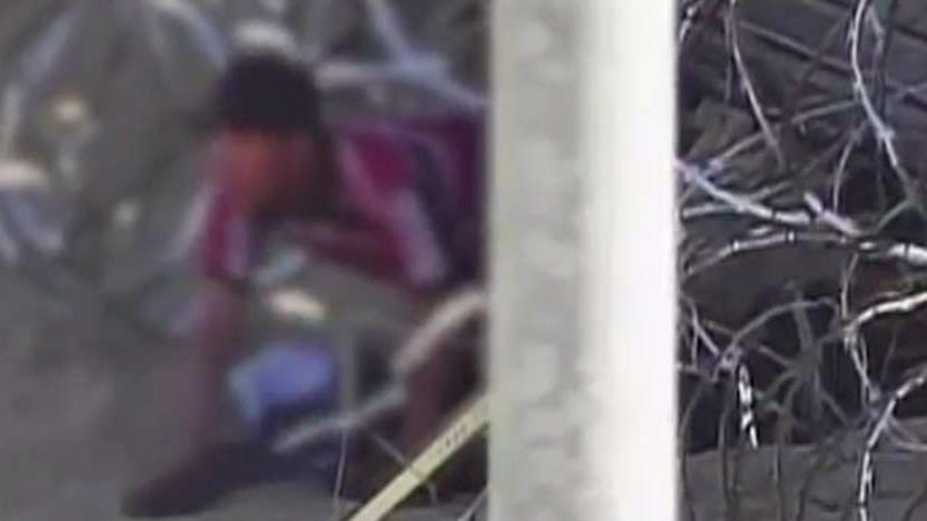 Video shows 171 migrants crawling through hole under border fence in Yuma, Arizona