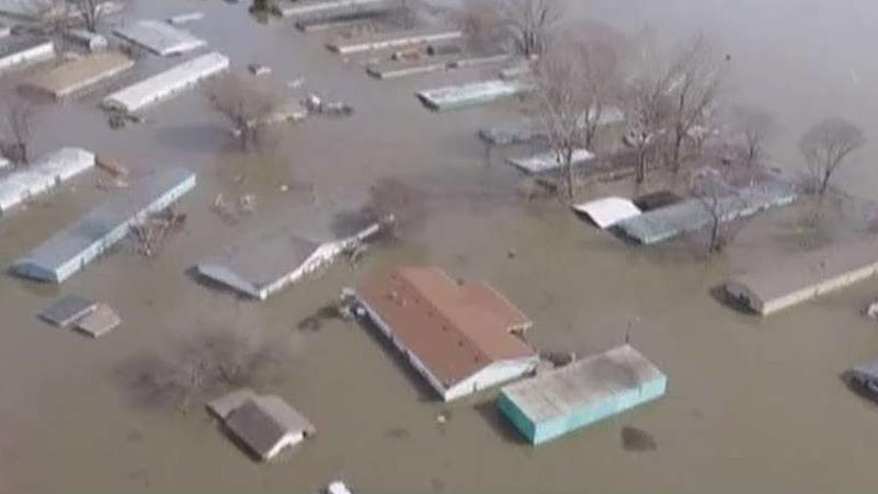 Floodwaters break through levees in Nebraska, Iowa and Missouri