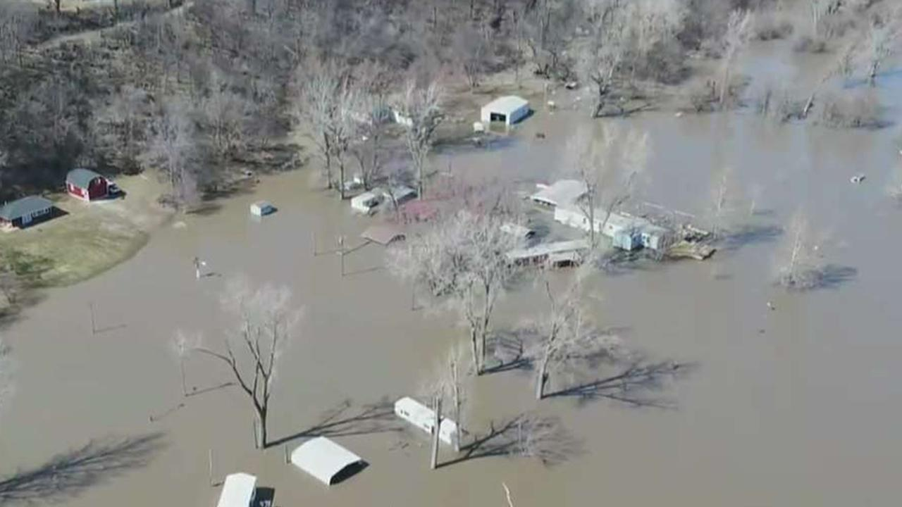 Fox News worker footage reveals towering border of Midwest flooding