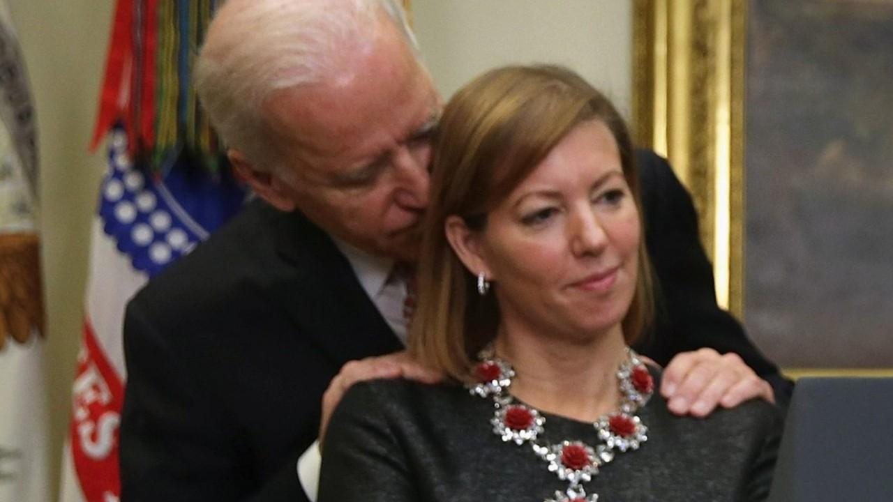 Wife of former Defense secretary calls photo with Biden misleading