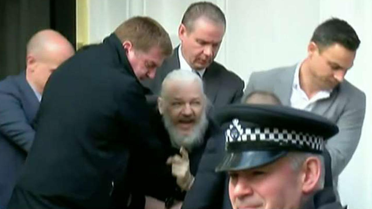 Julian Assange dragged out of Ecuadorian Embassy in handcuffs after arrest